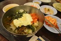 Bibimbap - rice with veggies. Kimchi right next to it